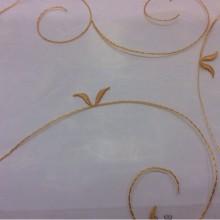 Органза для штор Trinity col 030. Италия, На прозрачном фоне атласные жёлтые завитки