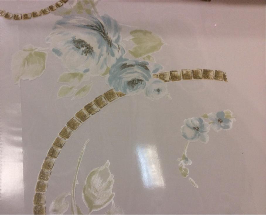 Тонкая тюлевая ткань с вискозной нитью  Ornella 30. Италия, Европа, тюль. На прозрачном фоне цветочный принт голубого оттенка купить в интернет-магазине Москва