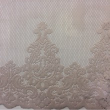 Купить ажурную ткань в Москве Darya 1155, col 401. Турецкая тюлевая ткань. Ажурная однородная сетка с фигурным низом бледно-розового оттенка