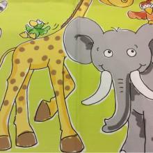 Детская ткань для штор с африканскими животными: жираф, слоник, зебра и птицы Jungla. Airjet. Col 9. Испания, Европа, портьерная. На салатовом фоне цветные фигурки животных