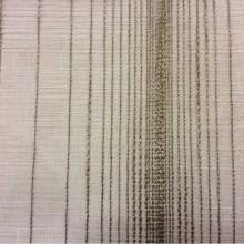 Купить тюль в салоне штор Palmyra, col 06. Италия, тюль для штор. На песочном фоне вертикальные хаотичные полосы бронзового оттенка