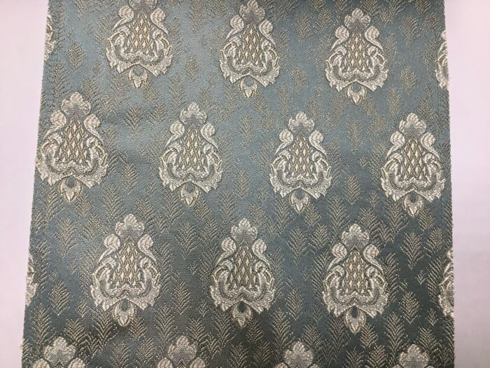 Портьерная жаккардовая ткань с мелким рисунком в классическом стиле голубая