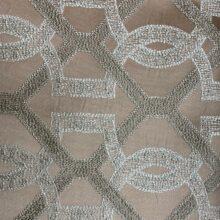 Портьерная жаккардовая ткань с геометрическим рисунком в тёмно-пудровых и бежевых оттенках