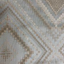 Портьерная жаккардовая ткань с геометрическим орнаментом в голубых и бежевых оттенках