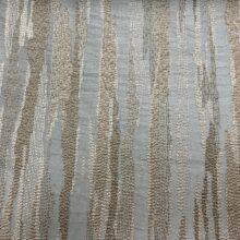 Портьерная жаккардовая ткань в вертикальную абстрактную полоску в голубых и бежевых оттенках